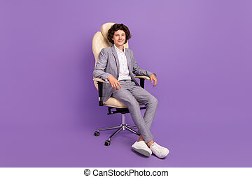Photo of confident schoolboy sit armchair enjoy school break wear grey suit isolated violet color background