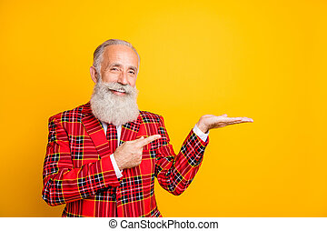 Photo of cool grandpa with white beard holding open palm indicating finger novelty product wear checkered red blazer tie outfit isolated yellow color background
