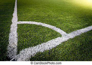 corner of soccer field lit by sun rays - Photo of corner of...