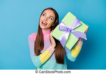 Photo of curious girl get gift box 14-february 8-march imagine wear pullover isolated over blue color background.
