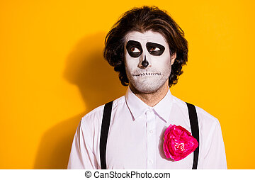Photo of curious unsure doubtful guy look up empty space think previous resurrection plan bad creating new wear white shirt rose death costume suspenders isolated yellow color background