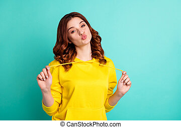Photo of curly charming sweet pretty cute nice young lady kissing you through air with lips pouted, playfully isolated over turquoise vivid color background