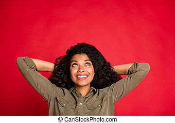 Photo of curly wavy cheerful positive nice pretty cute youngster looking up in search of interesing information holding head with hands isolated vivid color background