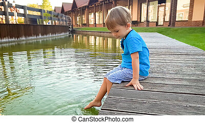 Photo of cute 3 years old little boy sitting on the ...