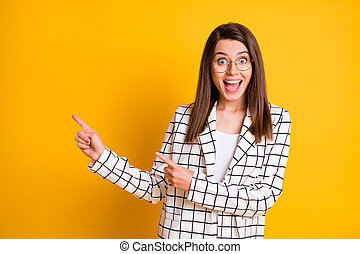 Photo of cute amazed journalist wear tartan blazer pointing fingers empty space open mouth isolated yellow color background