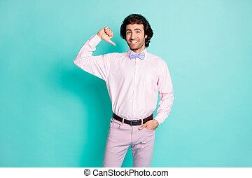 Photo of cute brunet curly man dressed pink outfit pointing thumb finger himself isolated teal color background