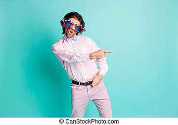 Photo of cute brunet wavy hair student dressed pink outfit dancing pointing one finger empty space isolated turquoise color background