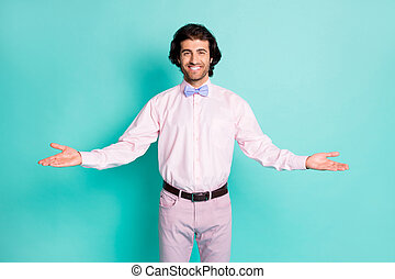 Photo of cute charming brunet wavy hair man dressed pink outfit welcome you open arms isolated teal color background