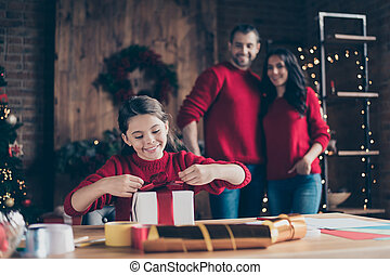 Photo of cute cheerful friendly people happy girl wearing red jumper unpacking received gift with her parents hugging embracing watching her reveal box