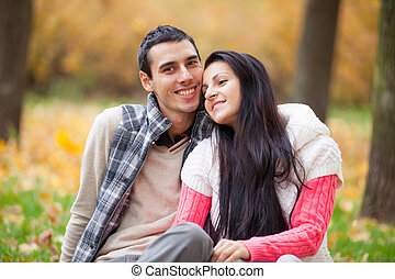 photo of cute couple hugging on the wonderful autumn park background