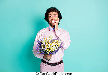 Photo of cute funny wavy hair man dressed pink shirt arm cheekbone bouquet isolated teal color background