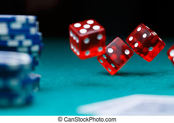 Photo of dice, chips in casino on green table