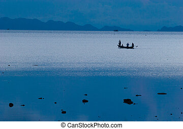Photo of fishermans in long tail boat tropical beach at...