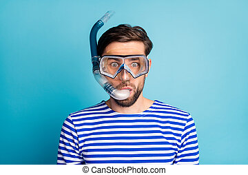 Photo of funky emotional handsome guy tourist diving underwater mask see colorful fish corals breathing tube floating deep wear striped sailor shirt isolated blue color background