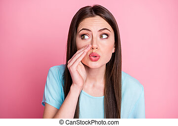 Photo of funny chatterbox lady say tell news gossips people wear casual t-shirt isolated pink pastel color background.