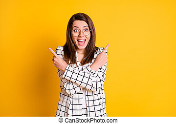 Photo of funny surprised business woman wear white checkered blazer pointing empty space two fingers open mouth isolated yellow color background