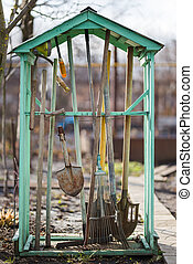 Photo of garden tools in the backyard