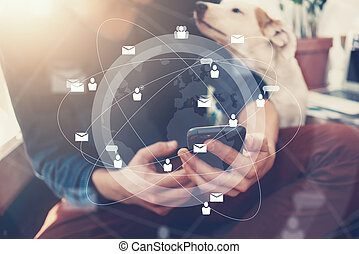 Photo of generic design smart phone holding in businessman hands texting message. Blurred background. Digital interface effect, socials networks. Horizontal mockup
