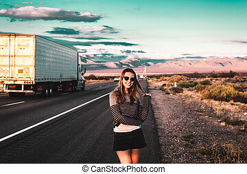 Girl at Mojave Desert near Route 66 in California