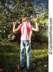 photo of girl hanging on clothesline