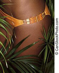 photo of girl thighs in orange bikini