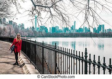 Girl walking near river at Central Park in Manhattan, New York City