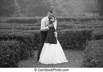 Photo of groom hugging bride at cold day