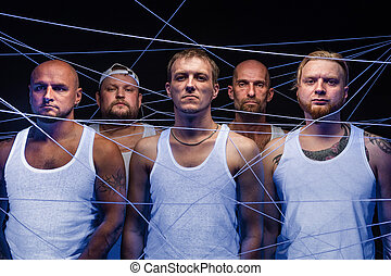 Photo of group of men tangled in white threads in ultraviolet