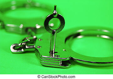 Handcuffs and Key - Photo of Handcuffs and Key.