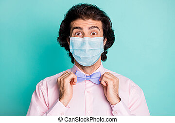 Photo of handsome cute boyfriend wear pink medical mask two arms fix bow tie isolated teal color background