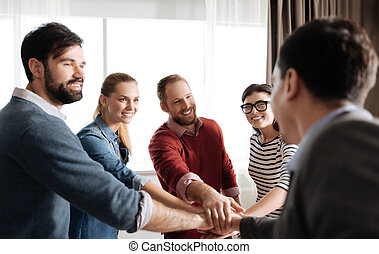 Photo of happy office workers while spending time together -...
