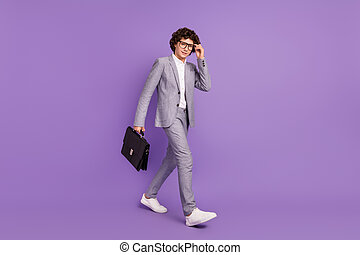 Photo of humble guy carry case back to school wear eyeglasses grey suit isolated purple color background