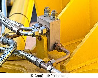 hydraulic tubes - photo of hydraulic tubes against yellow