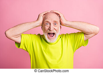 Photo of impressed aged man open mouth put arms on head lime outfit isolated on pink color background