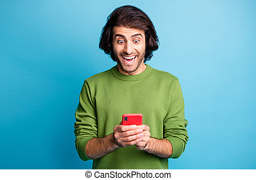 Photo of impressed handsome blog user like comment open mouth wear pullover isolated on blue color background