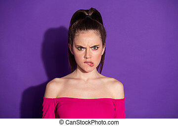 Photo of irritated girl bite her lips wear shine vivid clothes isolated over vibrant color background