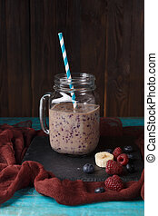 Photo of jar with smoothie on table