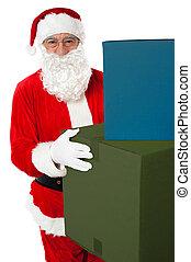 Photo of kind Santa Claus giving xmas presents