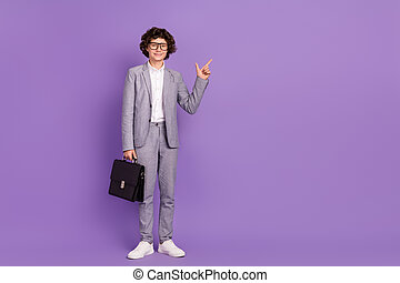 Photo of little schoolboy guy indicate forefinger empty space wear grey suit isolated purple color background