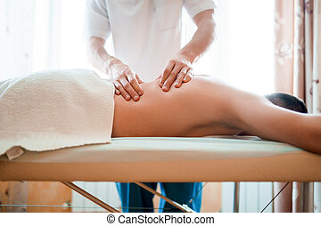 Photo of man therapist giving massage to man .