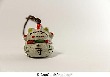 Maneki Neko - Japanese welcoming cat - with clipping path