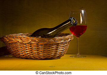 Photo of mature red wine with bottle
