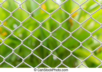 mesh fence closeup on blur backgroun - Photo of mesh fence...