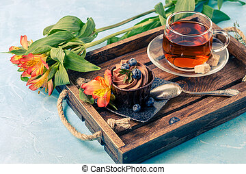Photo of morning cake, blueberries, black tea