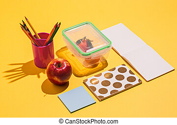 Photo of office and student gear over yellow background