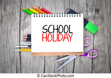 Photo of office and student gear with text SCHOOL HOLIDAY