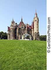 Photo of old castle in a sunny day, Castle Moszna, Poland.