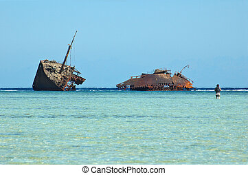 photo of old rusty ship run aground