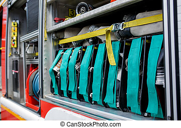 Photo of open fire truck with water hoses