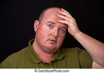 overweight male with heavy thoughts on his mind - photo of...